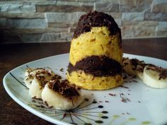 This  healthy mug cake is called Summer Duo, because the brown part is made of chocolate dough and the yellow include banana and coconut.  The brown part: 1 egg, 2 soup spoons of curd cheese, 2 - 3 soup spoons of flakes, 1 tea spoon of honey, 1 spoon of cacao, 1 square of honest chocolate. The yellow part: 1/2 of banana, 1 egg, 2 - 3 soup spoons of flakes, cca 1 soup spoon of crushed coconut, 1 soup spoon of curd cheese. Make a layers from this two colours of dough and bake it in microvave…