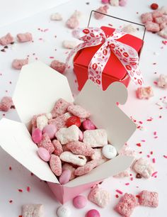 Valentine's Day Puppy Chow    You just melt the white chocolate (separately – there's white and red), mix it into the rice chex (again separately) and coat it with the powdered sugar for the vanilla cream and with the strawberry cake mix for the strawberry. Stir in the M and bam! Perfect treat!