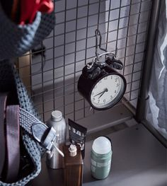 IKEA has lots of dorm decor and necessities like DEKAD alarm clock in black steel. It's battery-operated with an old-school look and is small enough to fit almost anywhere. We even hung it on the hook of a mesh steel room divider.