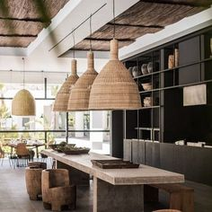 Whilst simple, the oversized pendants add warmth and wow to the amazing dining…
