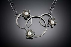 3-circle Daisy Pendant by Molly Dingledine. American Made. See the designer's work at the 2015 American Made Show, Washington DC. January 16-19, 2015. americanmadeshow.com #pendant, #necklace, #oxidizedsterlingsilver, #pearls, #jewelry, #americanmade