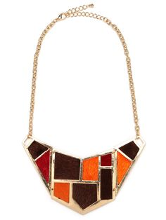 We love the reductive graphics in this stunning statement necklace. Subtly inspired by Dutch De Stijl style — think Mr. Mondrian — the look is both crafty and downright cool. Plus, it's right on with the color-blocking trend.