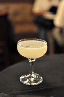 It's called a Corpse Reviver. #2. It brings back dead people for goodness sakes!   * 1 oz. gin  * 1 oz. Cointreau  * 1 oz. Lillet Blanc  * 1 oz. fresh lemon juice  * 1 dash absinthe  * Ice cubes  & garnish with an orange peel