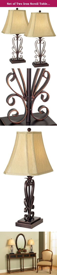 "Set of Two Iron Scroll Table Lamps. These pretty table lamps will dress up your decor. The wonderful iron scroll base design comes in a bronze finish with copper edging. The stacked rectangular base offers solid footing. A faux silk cut-corner shade tops each artistic design. The shades' rectangular shape allows for placement close to the wall. - Set of two. - Bronze and copper finish. - Faux silk shade. - Takes one 100 watt bulb (not included). - 26 1/2"" high. - Rectangular shades are 5""…"
