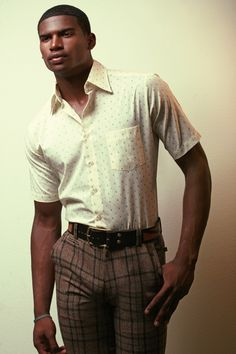 Well dressed retro in plaid slacks with vintage short sleeve shirt.
