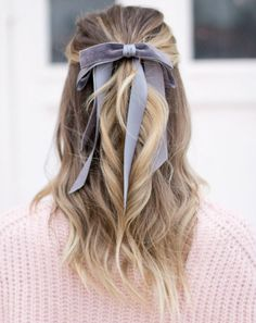 feminine gray bow with pink sweater