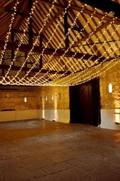 Single swag fairy light canopy, perfect backdrop for a barn wedding