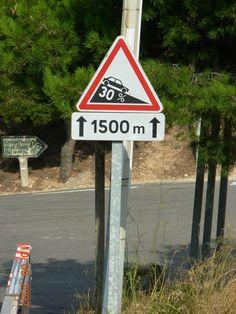 Slope warning sign, 30% over 1500 m. La Route des Crêtes, Cassis, France
