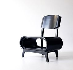 I like this squatty chair with storage space -- magazines, books, laptop -- but I wonder if it's comfortable.