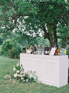 White wedding bar for cocktail hour with growing ground florals - Foxfire Monkton Al Fresco Summer Wedding — East Made Co Baltimore Maryland Wedding Planner with Photos by Michael & Carina, NFL Wedding featured on Style Me Pretty Cocktail Wedding Reception, Diy Wedding Bar, Tent Wedding, Wedding Receptions, Farm Wedding, Wedding Ideas, Fresco, Summer Wedding Decorations, Floral Wedding