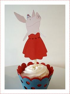 Olivia the Pig atop a yummy cupcake