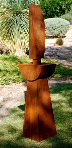 : MADONNA :  Corten Steel. The lines of a cloaked woman that transitions through the multiple circle sub base. The sub base then transitions into the base, which is of a chalice design. © 2010. Madonna Sculpture