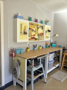 Build a DIY Workbench and Wall-Mount Pegboard Tool Cabinet with Sliding Doors, featured on Remodelaholic.com #tutorial #diy #tools #organized #pegboard #garage