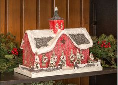 A traditional Red Barn Putz Christmas house all decked out for the Holidays with batting snow on the roof top, bottle brush trees. Sop Christmas Putz Houses Now!