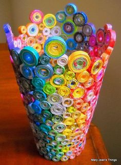 Upcycled rainbow base sculpture made from magazines, candy wrappers, catalogs, and coupon circulars