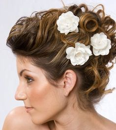 Pin curl updo adorned with delicate flowers