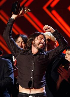 Dave Grohl....I love how when he does this, his shirts come up :3