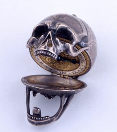 "Silver skull pocket Momento Mori Silver watch, 1650 -- engraved with Memento mori exhortations Incerta Mortis Hora/""the hour of death is uncertain"" -- it reminded the wearer to seize the day."