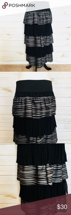 Ruffled Black and Gray Skirt This is a gorgeous ruffled custom made skirt! My seamstress made this beautiful skirt. It is a size large/xl. It has a nice, big comfortable waist band. ✨ Length 30 inches Waist 17.5 inches Hips 23 inches Skirts A-Line or Full