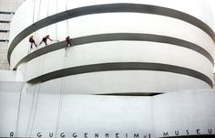 Workers cleaning the exterior of the Guggenheim on Friday morning -NYTimes.com