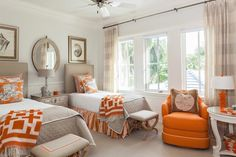 Joy Tribout Interior Design. A beautiful guest room, love the fresh orange with the shell/ beach theme.