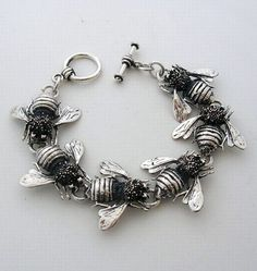 ≗ The Bee's Reverie ≗ silver bracelet by Avila Designs in the form of bees, symbols of productive industry.