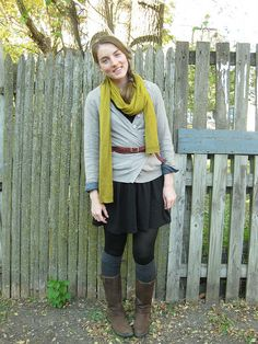 outfit: gray cardigan, green scarf, black skirt, tights, leg warmers, and brown boots. cute.