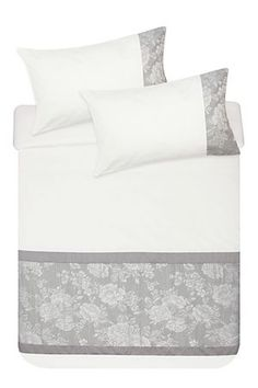 """This elegant rose jacquard duvet cover set has a polycotton cuff for added interest and will add a feminine touch to any bedroom setting. Single and three quarter include 1 standard pillowcase, double, queen and king include 2 standard pillowcases.<div class=""""pdpDescContent""""><BR /><BR /><b class=""""pdpDesc"""">Fabric Content:</b><BR />50% Polyester 50% Cotton<BR /><BR /><b class=""""pdpDesc"""">Wash Care:</b><BR>Lukewarm machine wash</div>"""