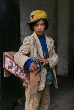 Shoe shine boy, Tibet