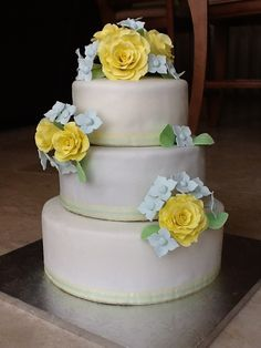 Wedding cake with hand sculpted sugar flowers.