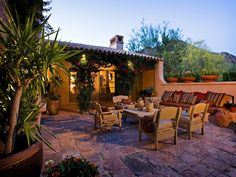 """This beautiful patio complements the historic home. """"Rustic and understated elements add personality and credibility,"""" says landscape architect Chad Robert."""