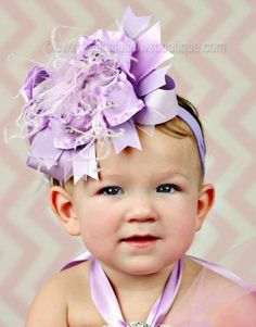 An over the top hair bow as lovely as a lilac flower a florist would envy! Gorgeous pale purple ribbons (smooth and frilled) gather together with lavender hued ostrich fea. Big Hair Bows, Toddler Hair Bows, Special Occasion Hairstyles, Holiday Hairstyles, Baby Girl Headbands, Baby Bows, Stacked Hair, Pageant Hair, Lavender Hair