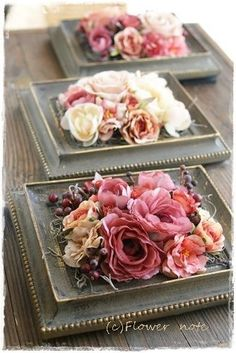 I've never seen frames used like this to hold a flower arrangement ... what a pretty idea!