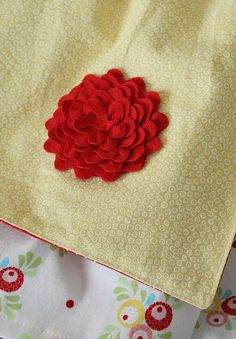 Lots of Great tutorials for different things. Pretty ric rac flower detail on bedding.
