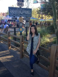 OOTD: Wearing a #VelvetTees #Camo Sleeveless Vest, #JBrand #Jeans, and #RebeccaMinkoff bag at the happiest place on earth #disneyland #wiw #fblog www.shoesandsashimi.com