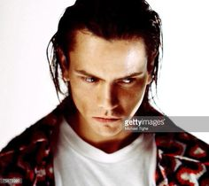 News Photo : Actor River Phoenix poses at a photoshoot in a...