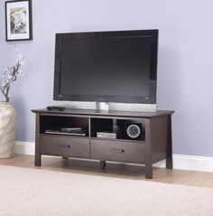 The Espresso Larissa TV Stand add simple style and media storage for a 47inch TV to any space. Shop for it and more Wood TV Stands at StacksAndStacks.com.