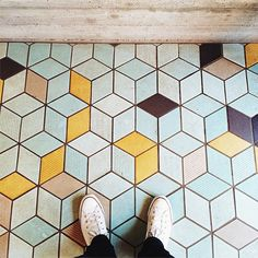 Lonny's Favorite #Floorcore Instagrams: @barclayd has two feet on a three-dimensional tile floor.