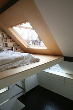 Vaulted ceiling with a loft bed space built in. Add a bookshelf and a window to curl up close to and stare out of and I'm sold. Great way for a small space to be made useful & cozy.