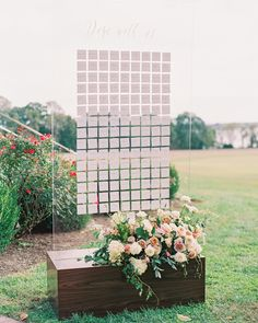 """Two acrylic and wooden walls displayed the light blue cards, which were adorned with white calligraphy. At top of the display, the phrase """"Dine with Us"""" served as an invitation for attendees. #Wedding #WeddingSigns #WeddingIdeas #Acrylic #WeddingInspiration #PlaceCards #Weddings #Wedding 