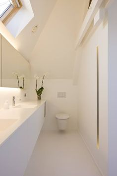 Attic bathroom, great use of space. I like the way it's been fitted out too, despite not being my style.
