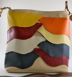 Multi Leather Overlay Tote.  What a fun way to use up small scraps of leather. Overlay in a ruffle-like fashion with multi-colored waves of leather. make it in a day.