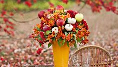 Create a bountiful bouquet full of fall flowers, mini gourds, and apples.