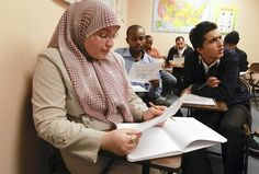 At RefugeeOne, a recent English class includes, from left, Sarah Al-Ameri, from Iraq; Imani Habinamwisho, from the Democratic Republic of the Congo; and Arman Shokouhi Rad, an Azerbaijani from Iran. (Terrence Antonio James, Chicago Tribune)