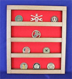 """This item is made of some old oak wood, it was stained some 50+ years ago and I sanded most of it off, leaving it on the insides and outsides of the slats, it was then clear coated with a clear satin finish. Holds 20 military unit coins based on a 2"""" coin, has red felt and comes with hardware to hang it with.     Item is 13 3/4"""" tall,  11 3/4"""" wide and 1 1/8"""" thick."""