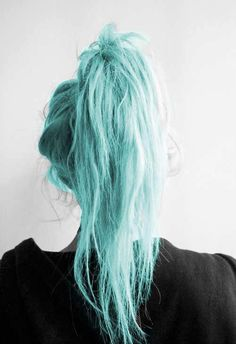 Blue hair in an up do style.