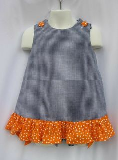 Items similar to Game Day! A-Line Gingham Auburn Ruffle Dress with Orange and White Dots and Applique/Embroidery on Etsy African Dresses For Kids, Toddler Girl Dresses, Little Girl Dresses, Baby Dress Design, Baby Girl Dress Patterns, Baby Frocks Designs, Kids Frocks Design, Baby Girl Frocks, Kids Dress Wear