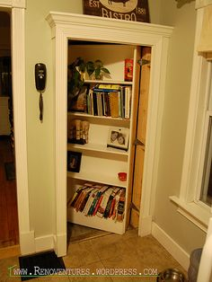 Hidden door to the basement ... It wasn't that difficult to build, my husband built it in a weekend. Our kitchen doesn't have a lot of storage and this gives us extra space to put cookbooks and various other things that end up in our kitchen!