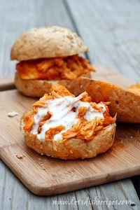 Shredded Buffalo Chicken sandwiches - **I made these with Cookies Wings N Things hot wing sauce. Everything cooked great in the crockpot, used 4 frozen chicken breasts. Makes great sliders.