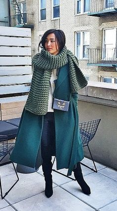 Blanket scarf with a teal green coat.